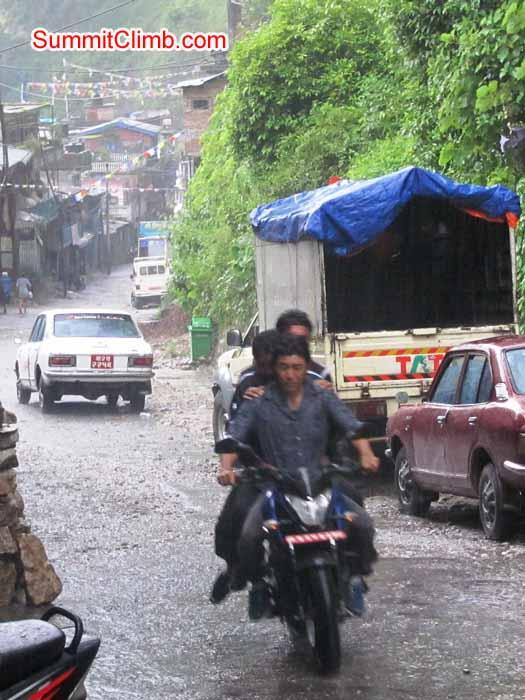 Motorbiking in the rain in Kodari, near Tibet border. Troy Bacon Photo