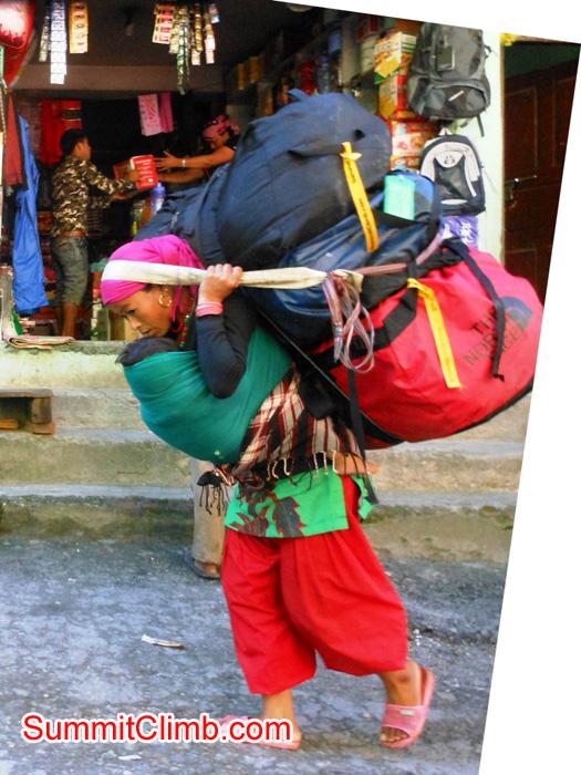 Porter carrying loads across the Nepal Tibet border. Stu Frink photo
