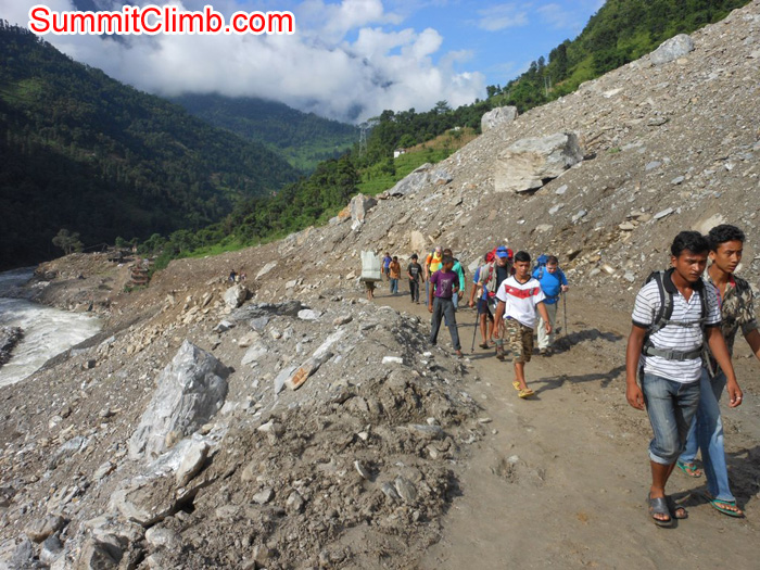 Trkking route through a massive landslide where 167 people were killed. May they Rest in Peace. Stu Frink Photo