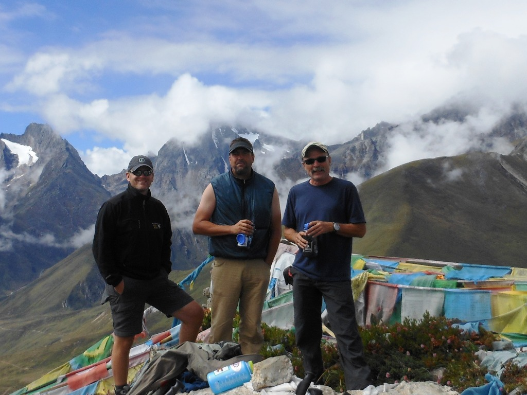 Troy, steve, and Kaley surrounded by peaks and prayer flags above Nyalam at 4375 metres - 14, 350 feet. Stu Frink Photo
