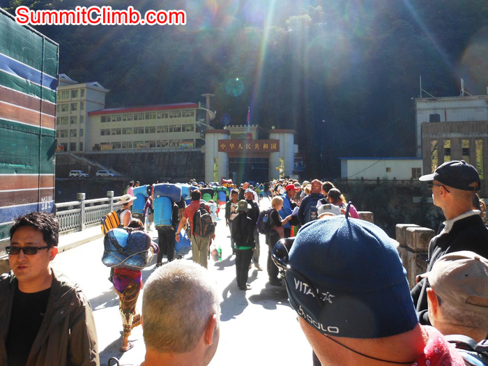 Walking across the Friendship Bridge toward the entry gate into Tibet. Stu Frink Photo