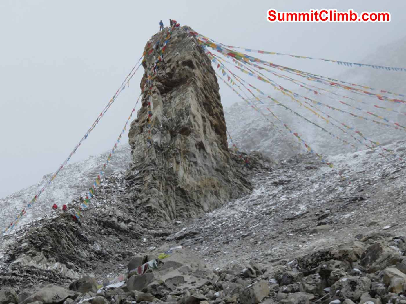 Prayer flags at Advance Base camp with Cho Oyu in the background by Kaley Erickson