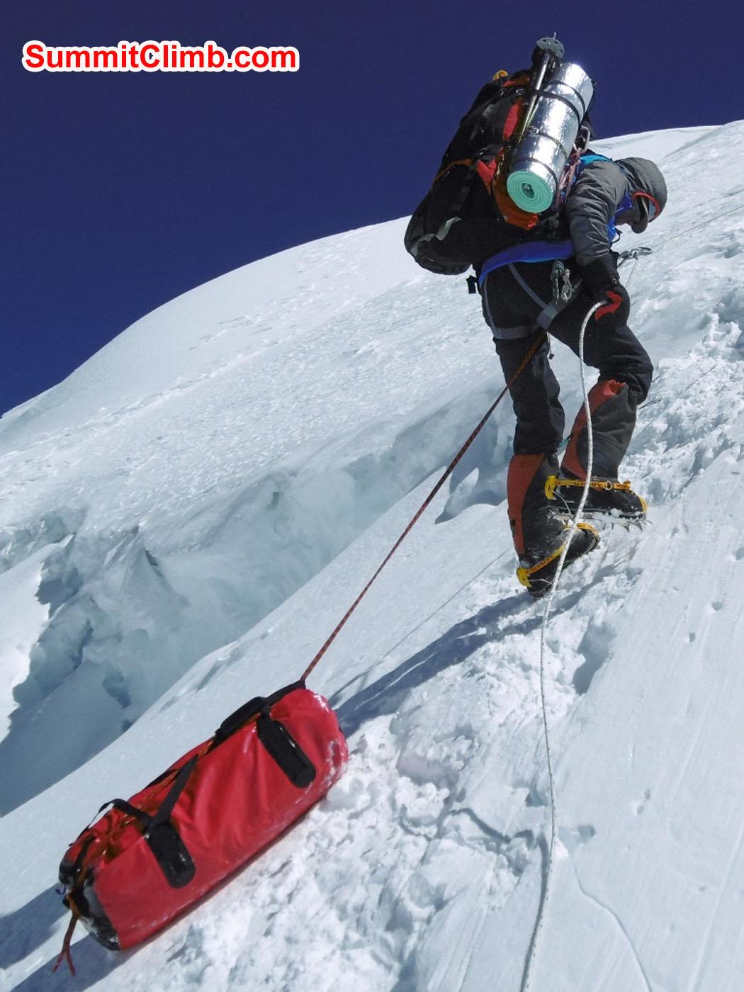 Christian, basic member, sliding his kit bag. Photo Stefan Simchen
