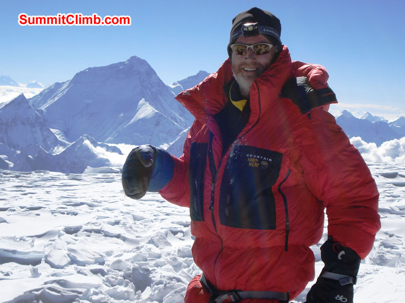Glenn with view of Everest on summit of Cho Oyu. Jangbu Sherpa Photo.