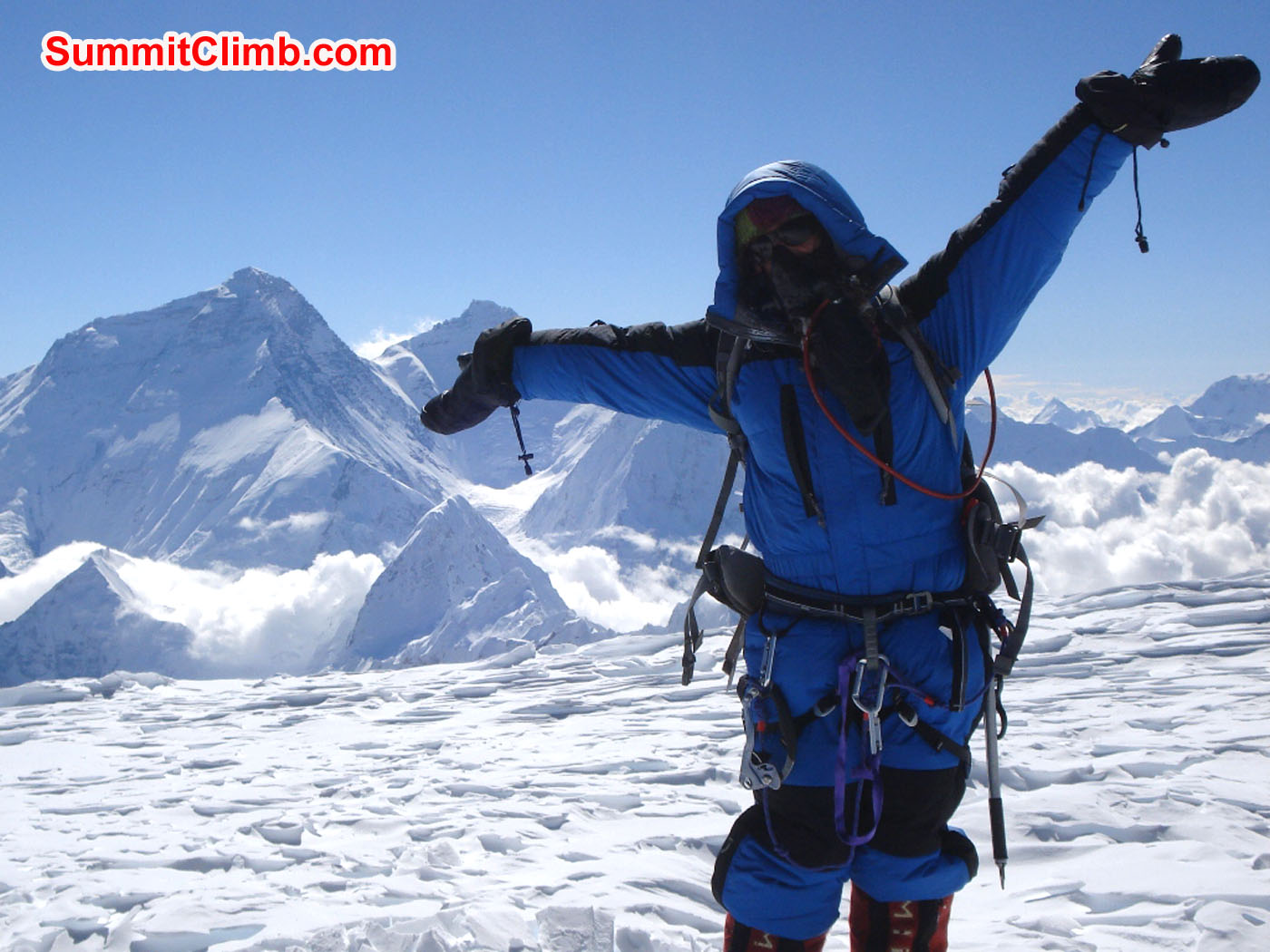 Marina Cortes on the Summit with Everest View. Jangbu Sherpa Photo