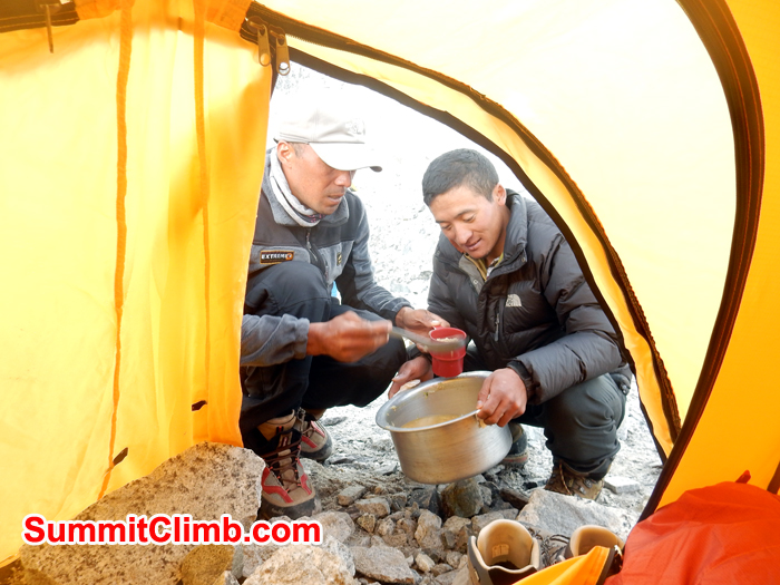 Tenji and Ang Pasang serving food in Tent. Photo Erik