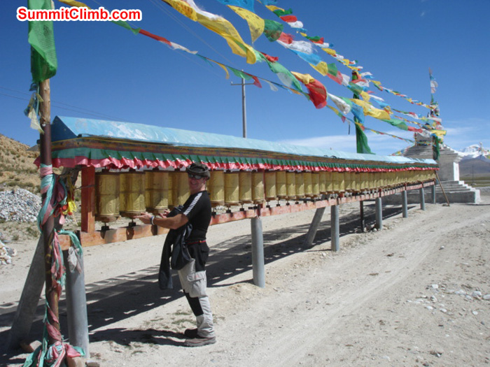 James Grieve spinning prayer wheels in Tingri. Matt Olsen Photo