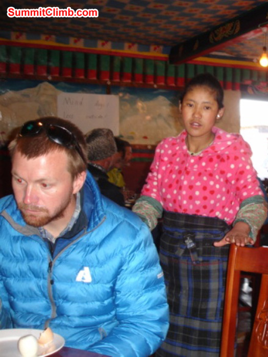 Matt Olsen and Dawa in the dining room in Tingri. Photo by James Grieve