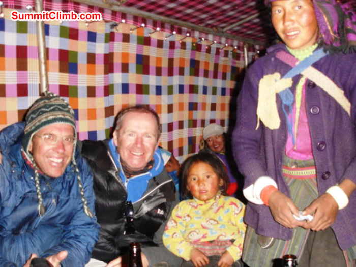 Dan, James, Chutin and Mama Chutin staying warm in the teahouse at Gyepla. James Grieve Photo