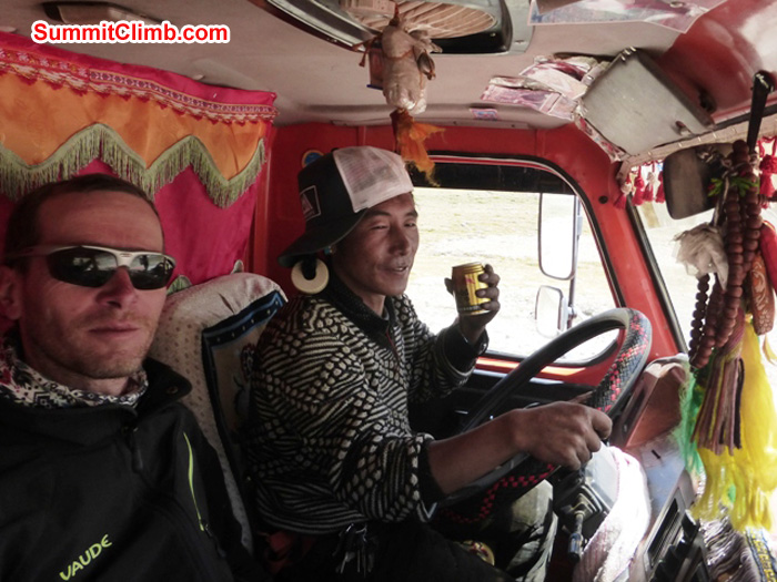 Juergen Landmann hitches a ride in a Japanese cargo truck while Hapa, the driver, sips a red bull. Dan Mazur Photo