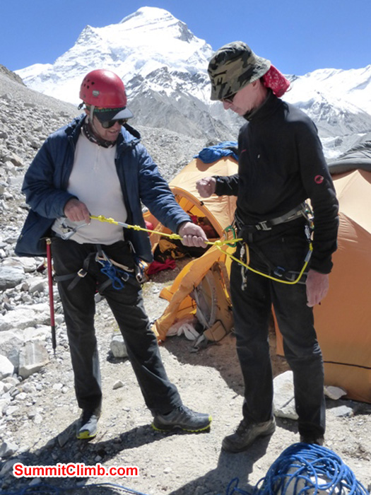 Dan and Matti sorting out their equipment in abc, with cho oyu in the background. Juergen Landmann Photo