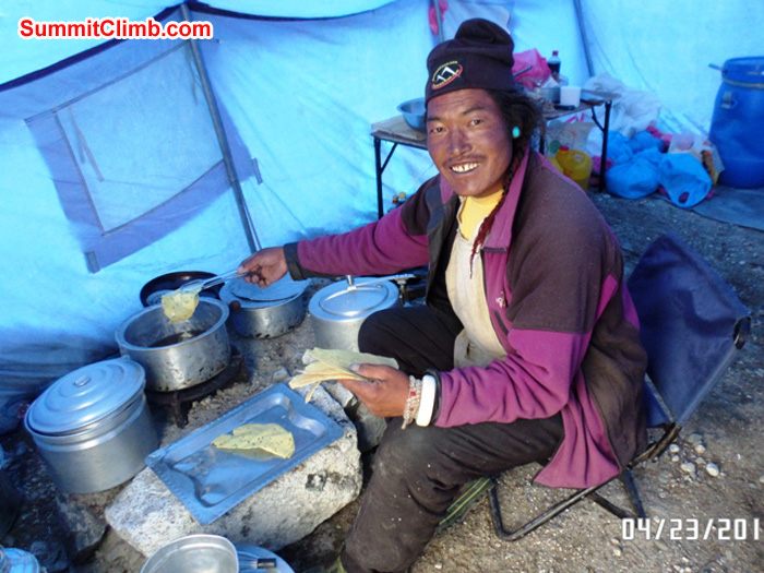Chimi prepares a delicious lunch after a hard day on the ice. Photo by Ang Pasang Sherpa
