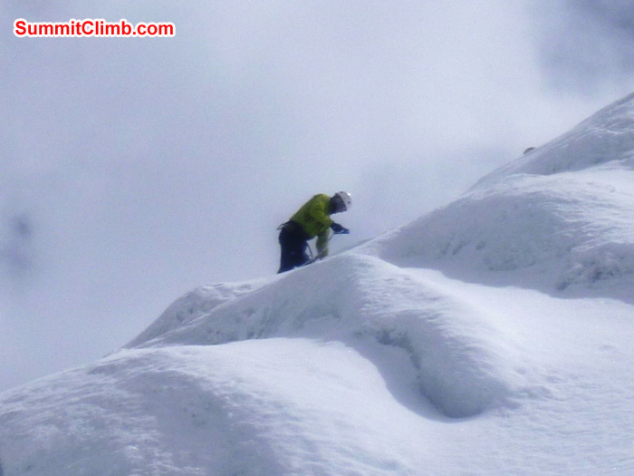 JJ climbs the ice pinnacle near basecamp during team ice training, Photo by Matt Olsen