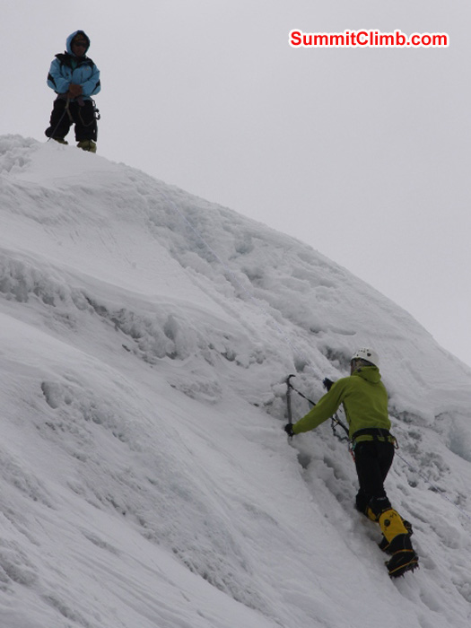 JJ climbs ice while Jangbu Sherpa instructs during ice trainng in ABC. Matti Sunell Photo