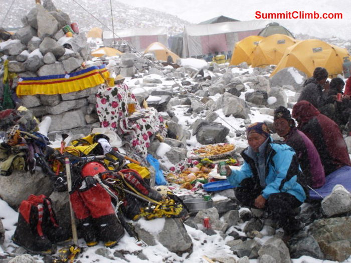 Puja blessing ceremony in advanced basecamp during a snow storm. Climbing gear gets blessed too. Thats Jangbu Sherpa sitting beside the Lama and Dan. Ang Pasang Photo