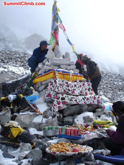 Stringing up prayer flags at the Puja basecamp blessing ceremony. Lama prays while all of the offerings are displayed beside himJames Grieve photo