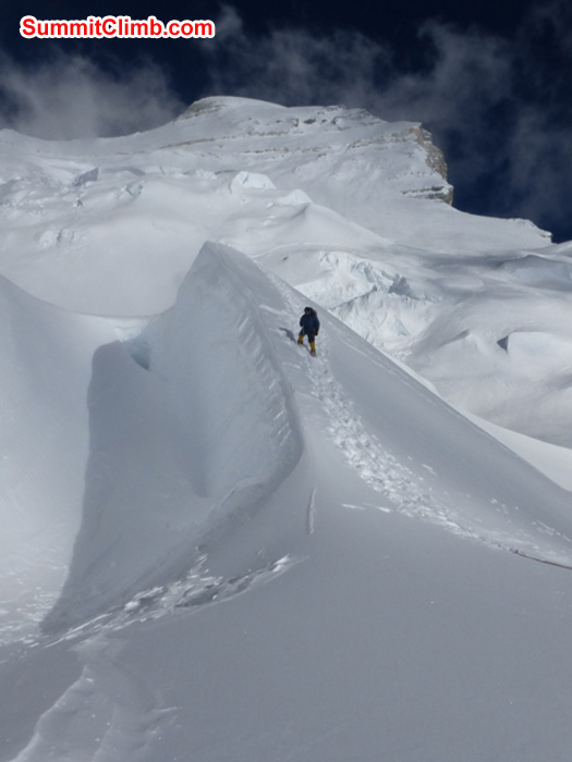 Ang Pasang crests the last frozen snow wave before camp 1.5. Juergen Landmann Photo