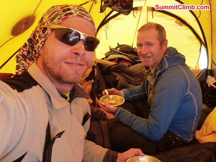 Juergen ad James, eating breakfast in camp 1.5. Juergen Landmann Photo
