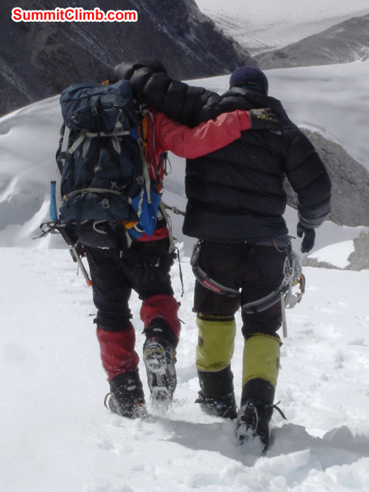 After the avalanche. Injured Sherpas from a different group, helping one another descend down to camp 1. Jangbu Sherpa Photo