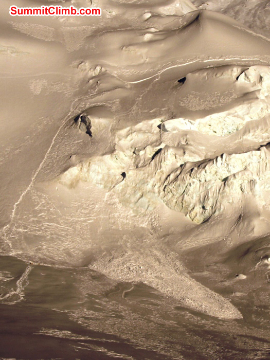 Avalanche tragedy above camp 1.5 . Climbers triggered it at the top f the photo and they were swept over the ice cliffs in the center. Photo by Matti Sunell