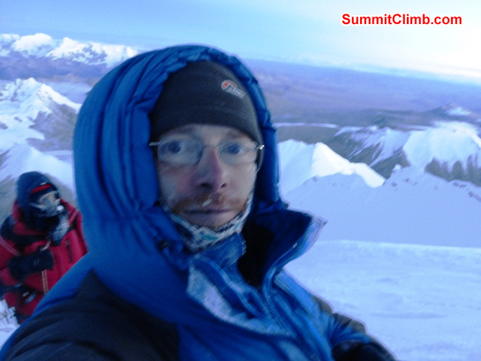 Dan and Juergen Landmann with Tibetan Plateau in the background on summit morning. Juergen Landmann Photo