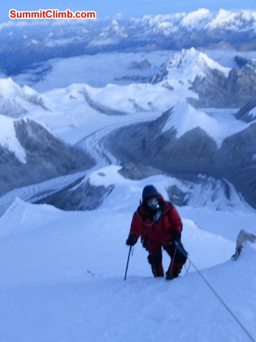 Dan climbing to the summit with camps 3, 2, 1, Abc, Bc, Gyebrag glacier, and Mount Shishapangma in background. Juergen Landmann Photo