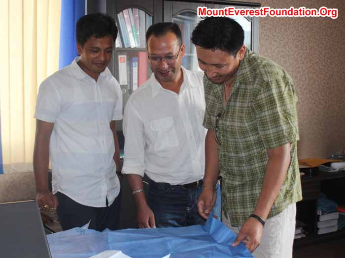 Observing the blue print of Deboche Nunnery. From left Rajendra Pradhan – Engineer, Subodh Shrestha, and Mingma Sherpa. Photo Subodh Shrestha.