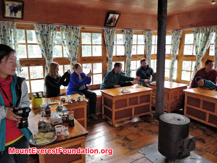 Team and young monks are in tea house