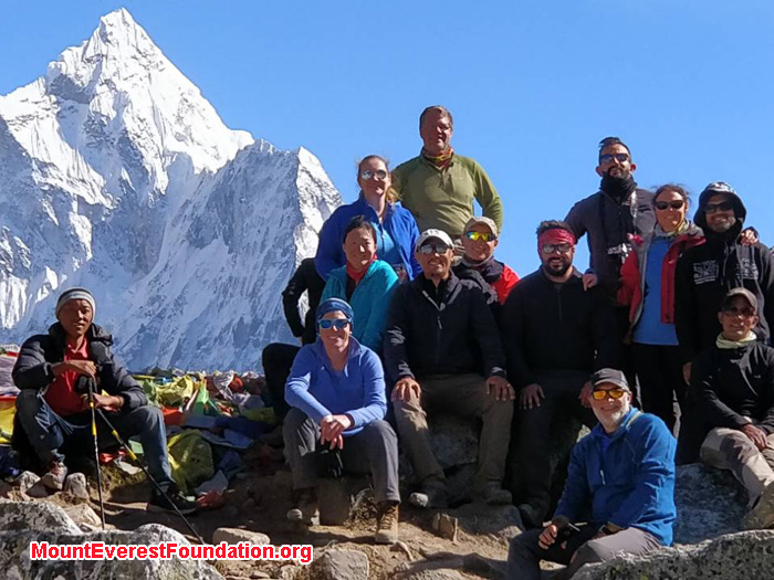 team members with mountain