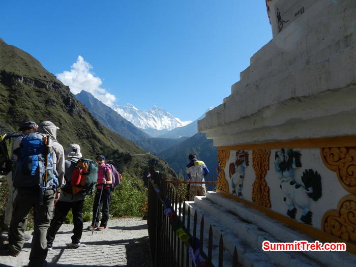 Resting team just below Namche with view of Nuptse, Lhotse, Everest and Ama Dablam. Photo by Stephanie