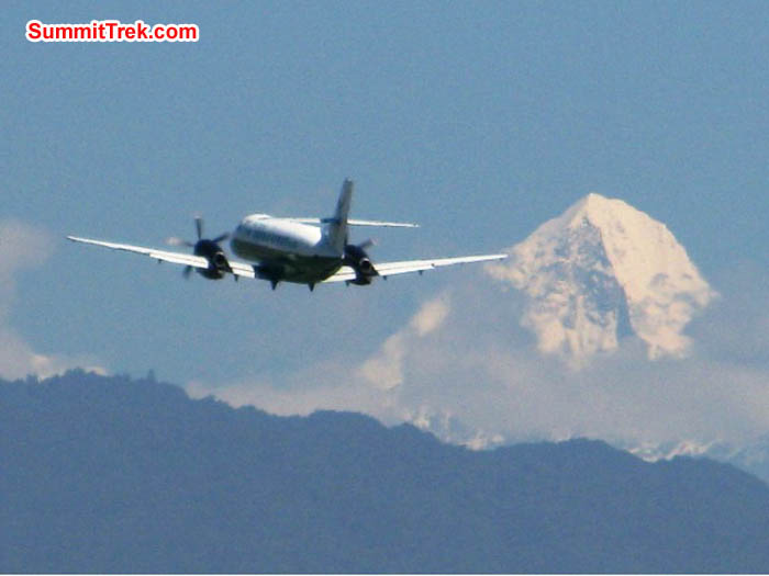 Plane takes off from the Kathmandu airport in front of Mount Ganesh. Keith Bailey Photo