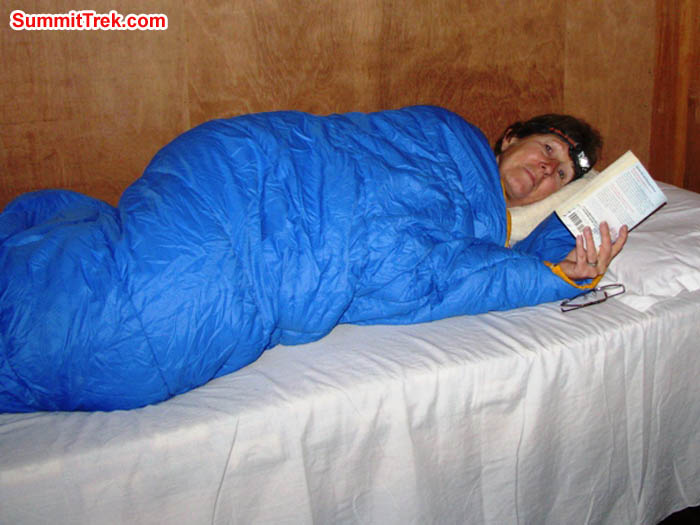 Dee Haberern enjoying a good book and a warm sleeping bag. Photo by Ron Haberern