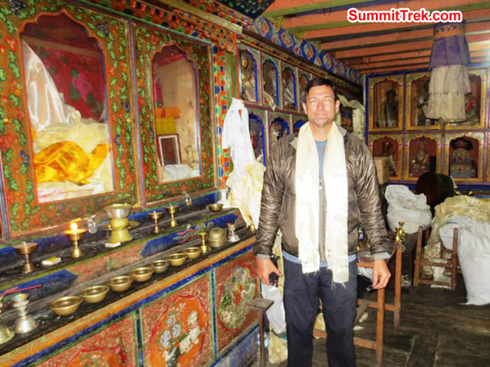 Brian Rolfson poses in front of th altar at the Pangbaoche temple. Hannah Rolfson photo.