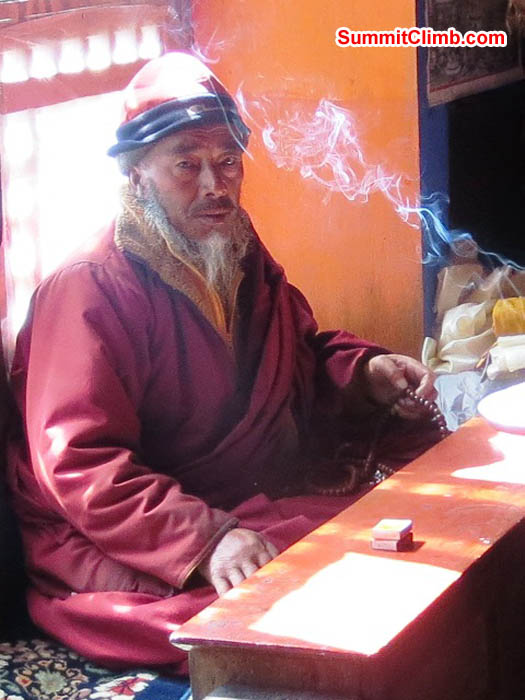 Pangboche lama prepares to conduct his daily prayer. Hannah Rolfson Photo