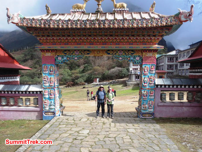 Brian and Hannah Rolson at the gate to Tyengboche Monastery. Lakpa Gyeluk Sherpa Photo