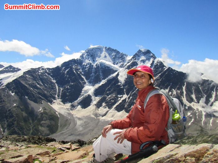 Ms. Pramila Kumari resting behind beautiful mountain.