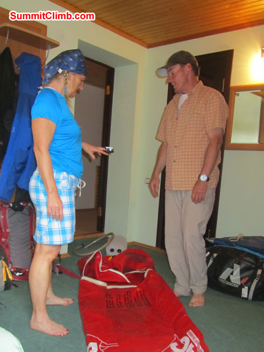 Jules Lewis and Scott Patch reviewing safety equipment after a day of acclimatization in the mountains above Cheget. Photo Pramila Kumari.