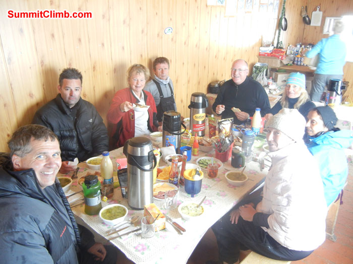 Expedition members eating dinner in our dining hut at Elbrus base camp. Photo Scott Patch