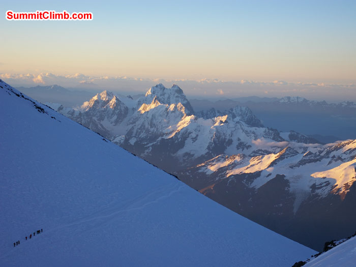 Climbers almost to saddle on summit day with Mount Ushba (Ушба), 4,710 m (15,453 ft), in background. Ushba is known as the