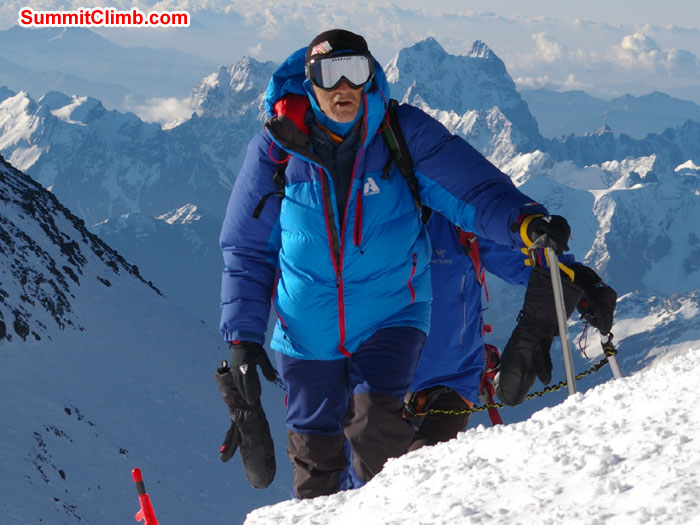 Dan Haraburda reaching the summit plateau with Mount Ushba in background. Photo Scott Patch.