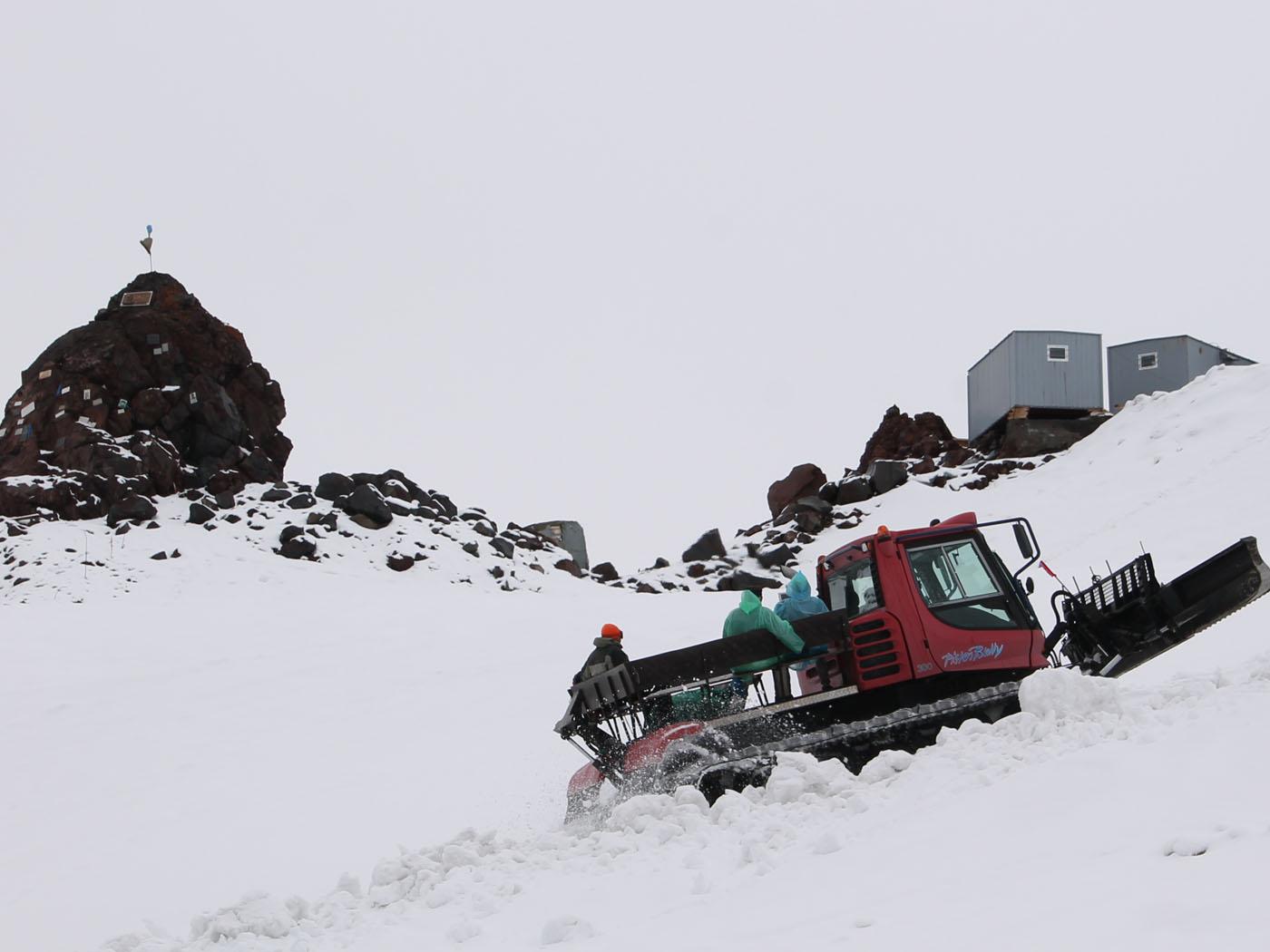Snowcat in uphill