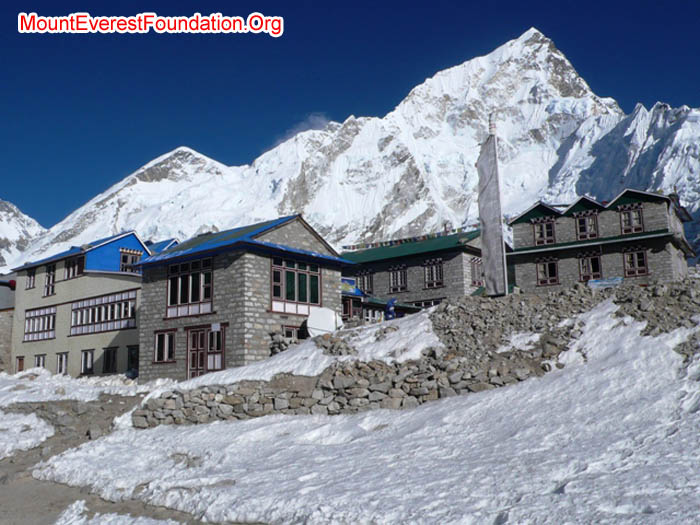 Gorak Shep on a snowy sunny day in November. In background are Cholatse, West Ridge of Everest, Everest Summit, and Nuptse.
