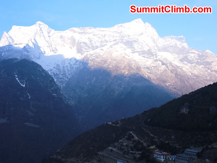 Sunrise well above Namche. This is a Kwangde. Next to it on the left is Numbur. Photo was taken very early as the sun was cresting various peaks by Neal Kushwaha.
