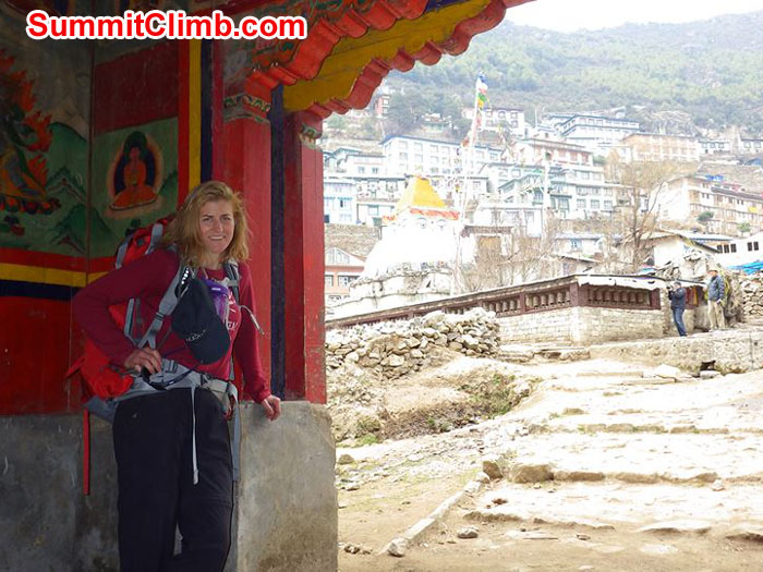 2 Christie at the entrance to Namche upon her arrival after a 6 hour hike from Phakding. Photographer: Liam