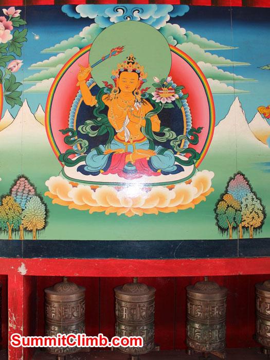 A Buddhist Deity and Prayer Wheels at Namche Bazaar. Photo by Sam Chappatte