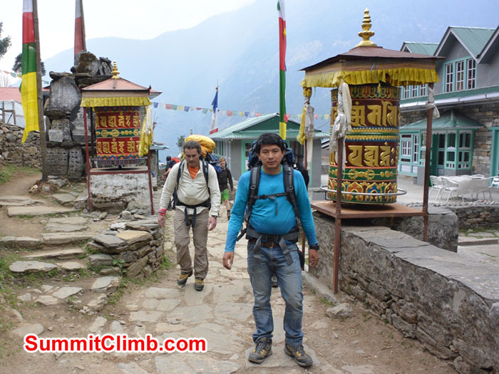 Laxman and Karel crossing through Ghat Village. Photo by Mike Fairman