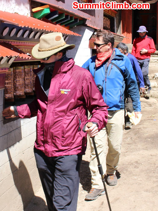 Mike, Scott, Lakpa and Carlos spinning prayer wheels at Pangboche Gompa. Sam Chappatte Photo