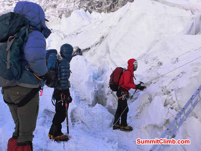 Paula, Alexandra, and Sam considering a ladder near Everest basecamp. Photo by Mike Fairman