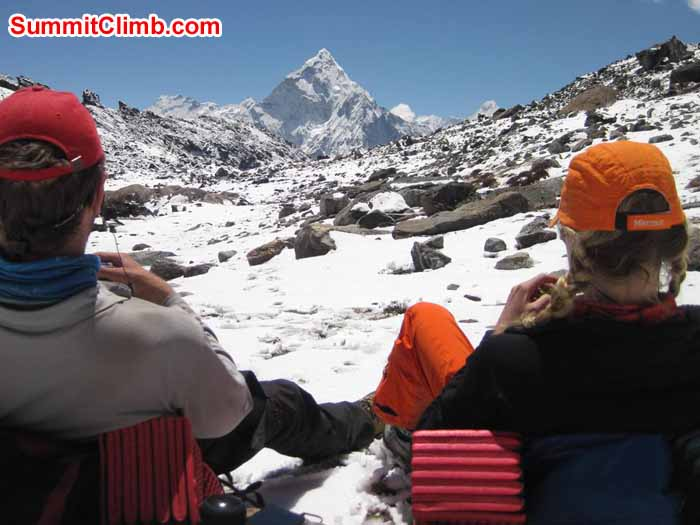 Sam and Alexandra relax at Lobuche base camp looking out at Ama Dablam photo by Patrick McKnight