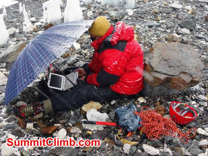 Dan browsing the internet on the Khumbu Glacier near Everest Basecamp. Photo David Maidment